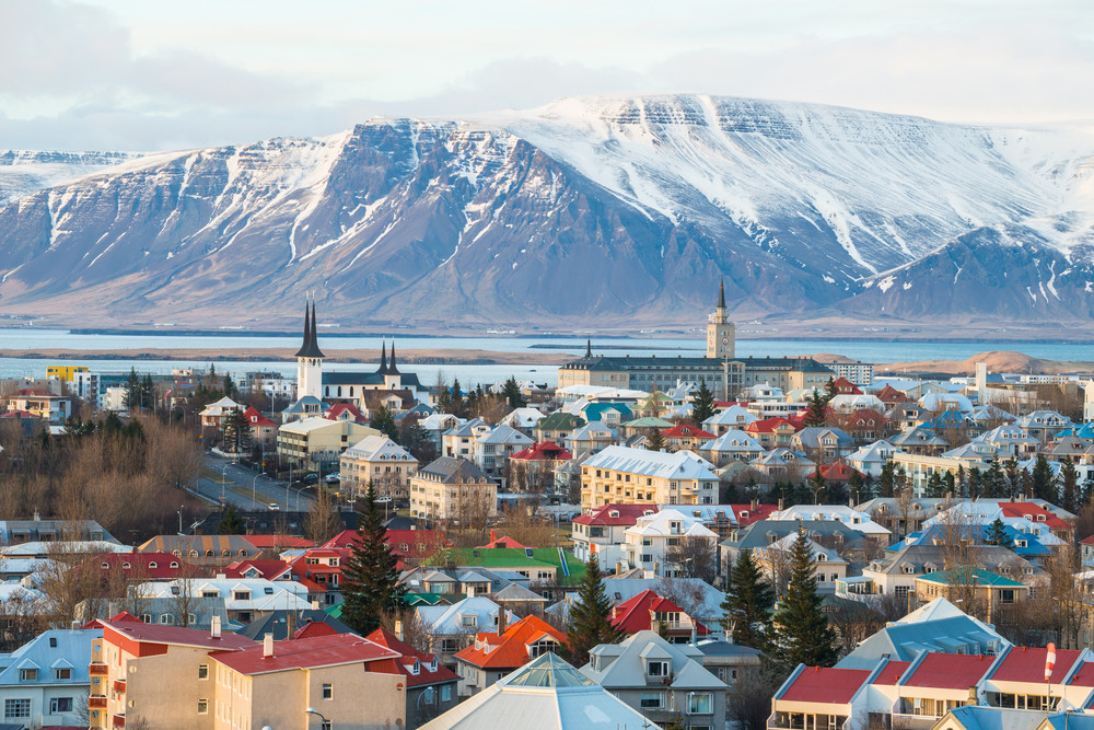 Colourful view of Reykjavik with snowy mountains. Iceland Airwaves Festival.