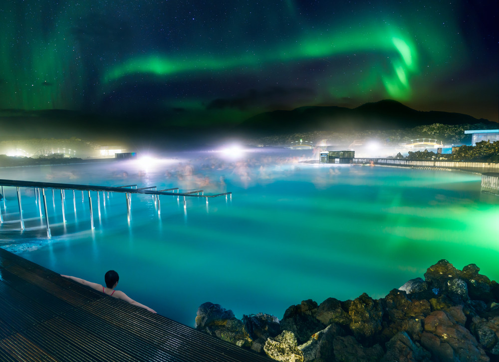 The Northern Lights in the sky over the Blue Lagoon Iceland.