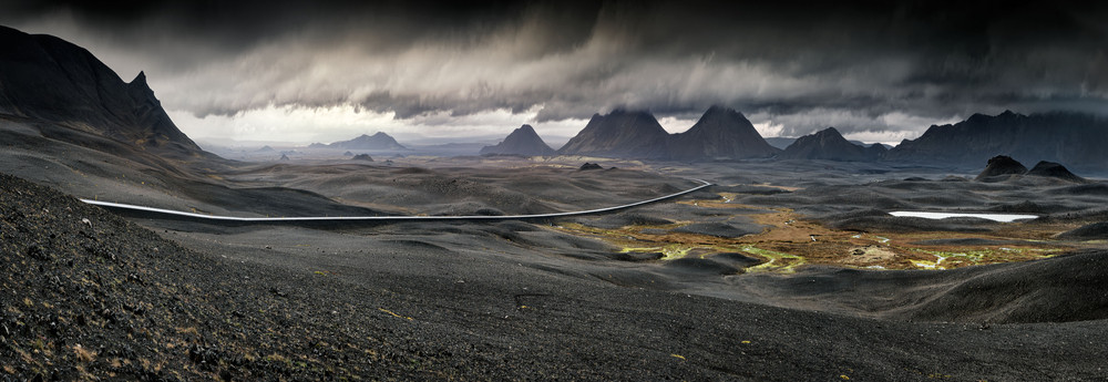 Low cloud and stormy skies over a wide volcanic landscape. Iceland Photography tips.