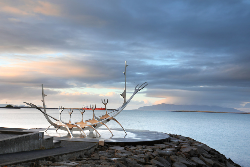 Sun Voyager boat-like sculpture on a plinth next to the ocean. There is lots of art outside of the art galleries in Iceland
