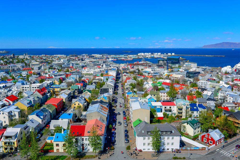 colourful houses of Reykjavik with the sea and blue sky beyond. Explore with your Reykjavik City Card