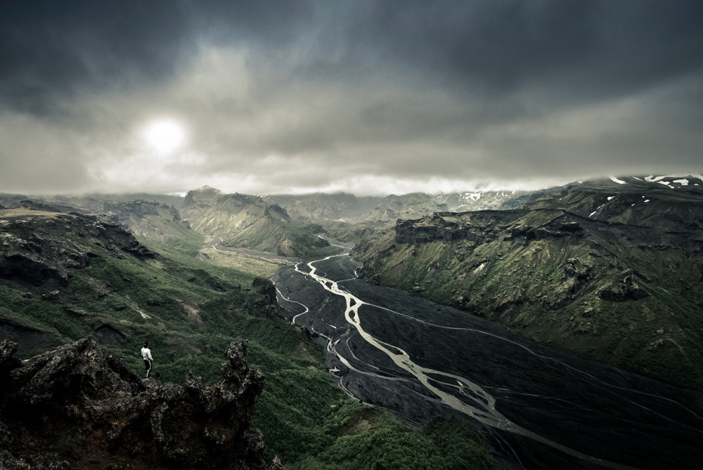 Moody view of Iceland Highlands with brooding sky and dark volcanic mountains.