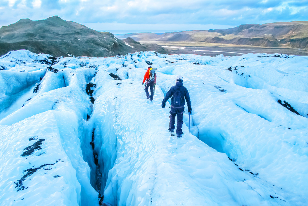 Two hikers on the incredible glaciers of Iceland