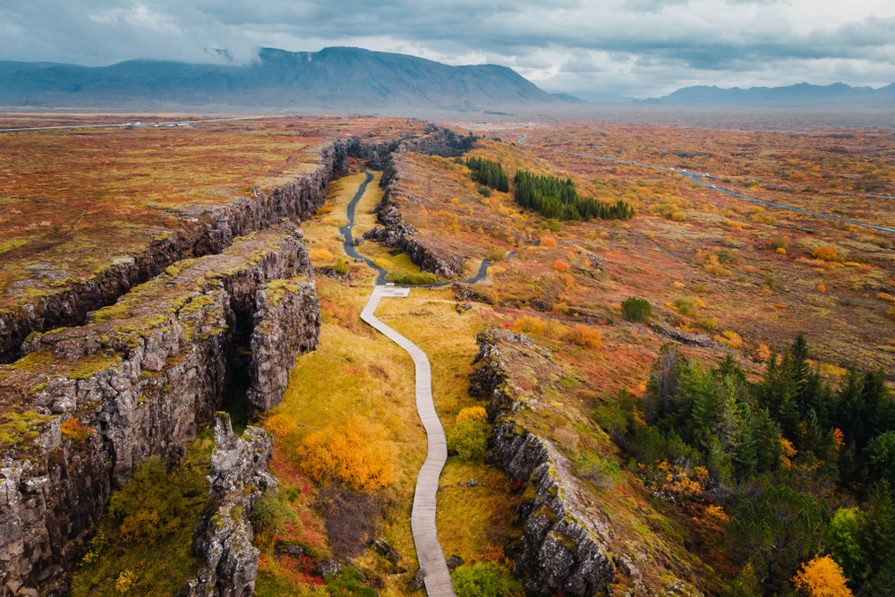 Pathway through a rocky canyon with autumn hues. Iceland in fall.
