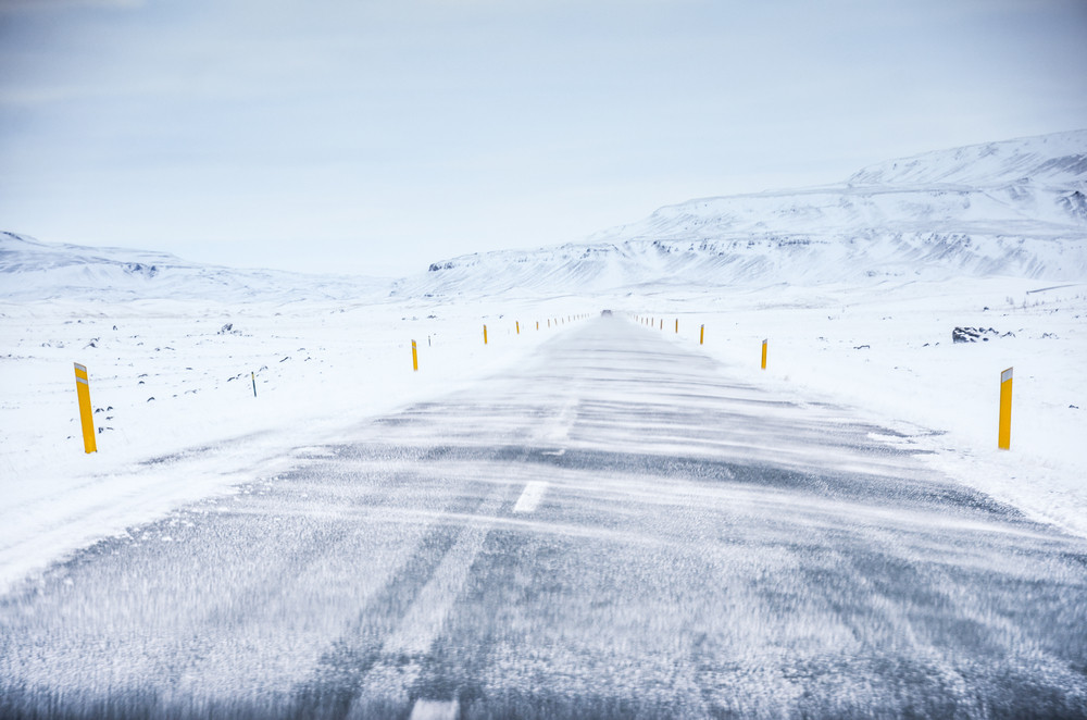 Snow blowing across an empty highway. Just how windy is Iceland?