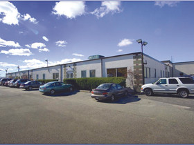 Long Island Industrial signs lease with FLOS Lighting