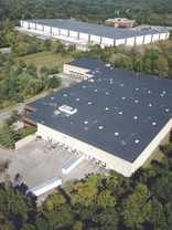 NAI James E. Hanson secures buyer for 156,627 s/f ind. bldg.