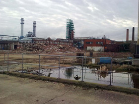 Environmental risk advisory and insurance placement for brownfield development