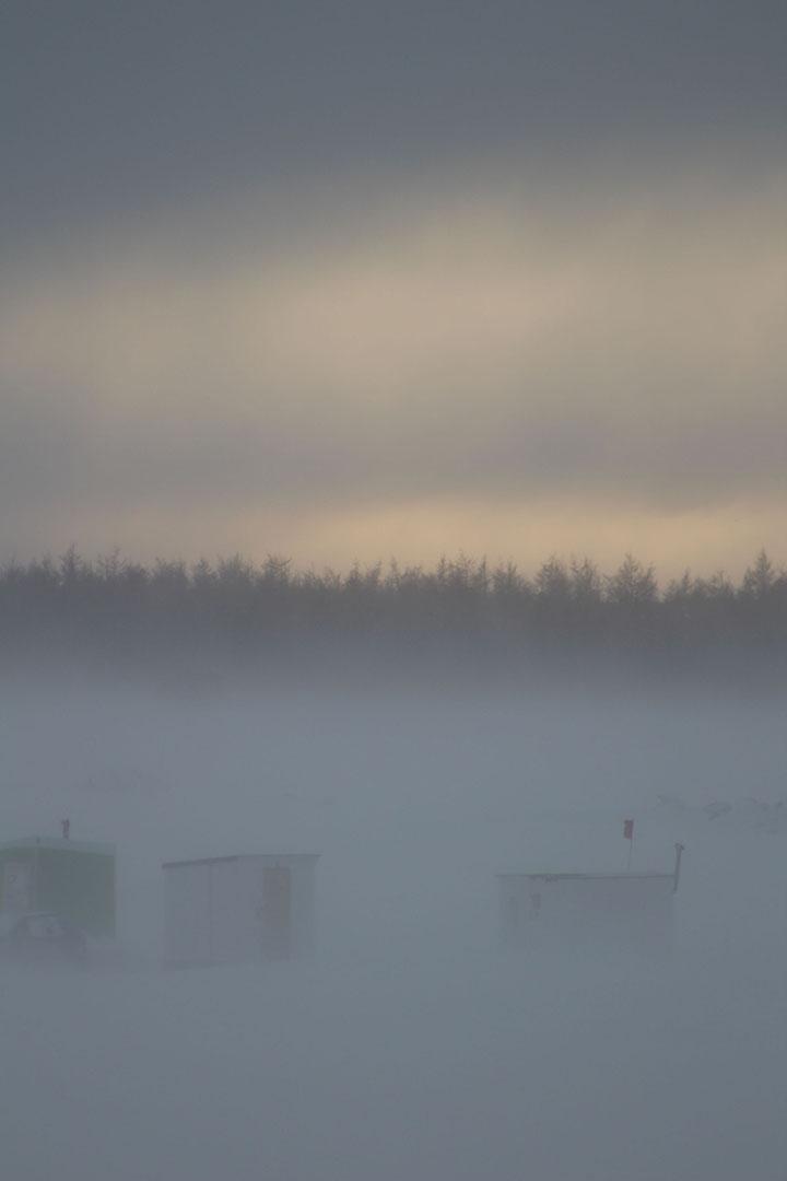 Cabanes dans la poudrerie