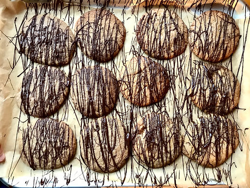 Ginger Biscuits being given a chocolate coating.