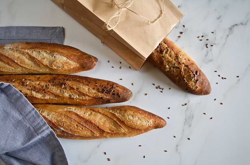 The Loaf Tin's famous French Baguettes - here are our standard white and seeded wholemeal variety.