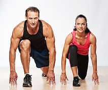 Athletic man and woman doing fitness exe