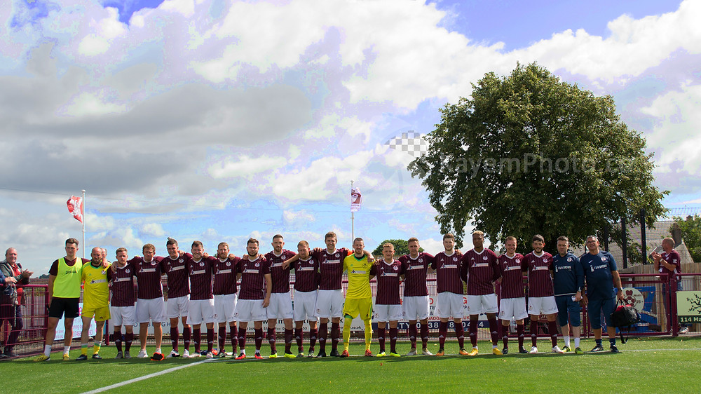 Kelty unfulr the East of Scotland Champions flag
