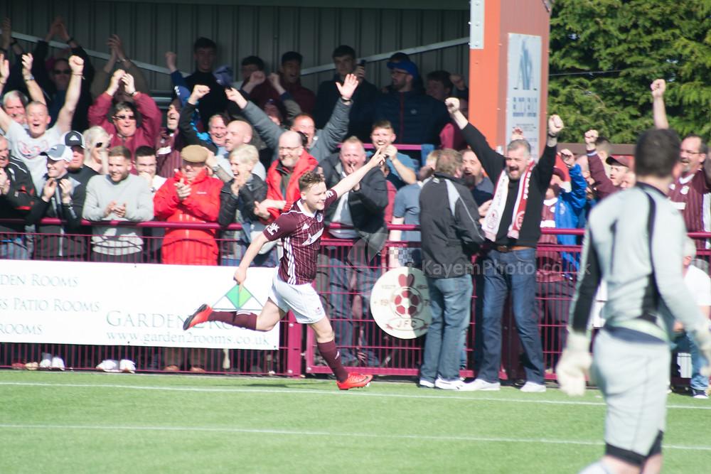 Mackenzie celebrates scoring against his old team