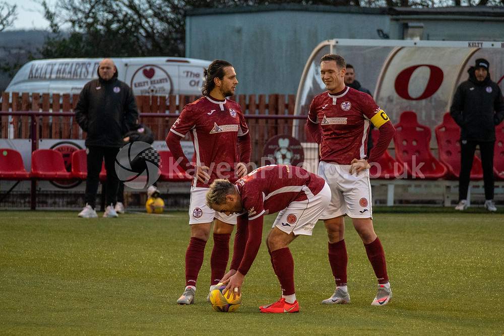 Tidser, Easton & Stevenson over a Kelty free kick