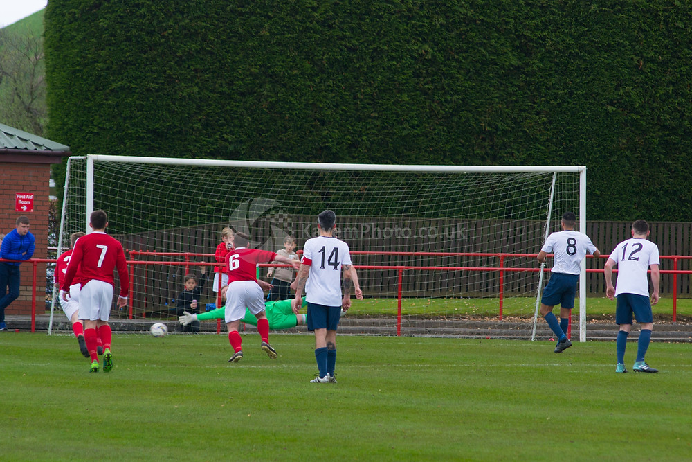 Holt equalises from the penalty spot