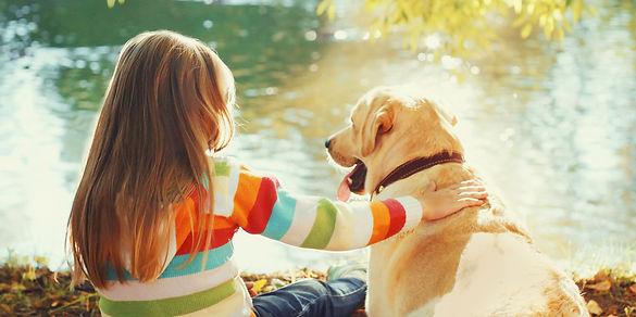 Little Girl Sitting with Labrador.jpg