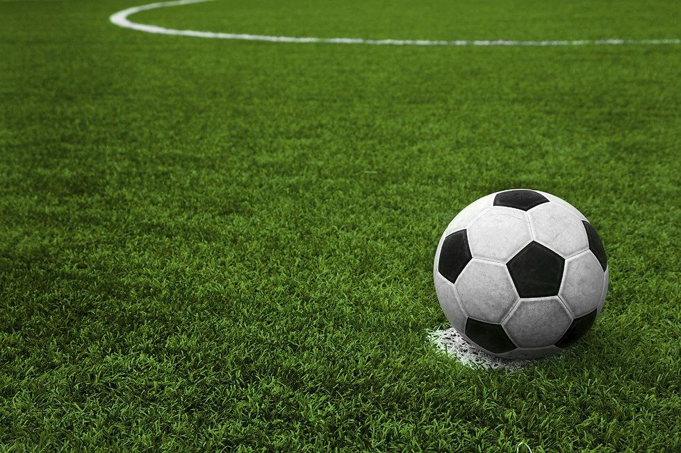 soccer ball on turf.jpg