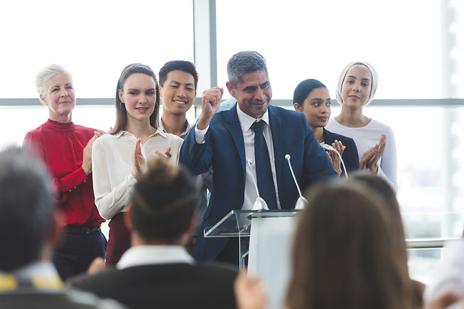 businessman-standing-with-diverse-collea