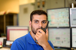 Man-working-in-control-room-860138316_12