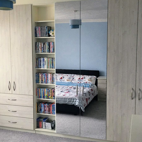 Fitted bedroom in Morecambe - It's a mirror...but it's got all the properties of wood.