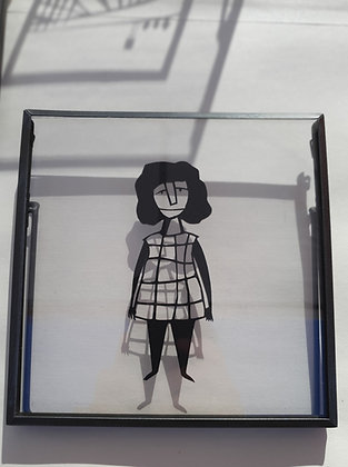 Figure of a woman in a plaid dress