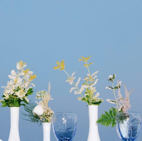 Bud vases against blue sky