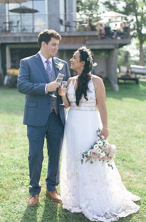 Bride and Groom cheers at a Nova Scotia Vineyard Wedding