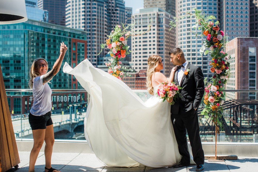 Connecticut wedding designer flipping up bride's dress for stunning photos