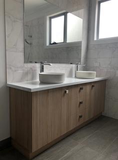 Timber laminate bathroom vanity with laminated tops