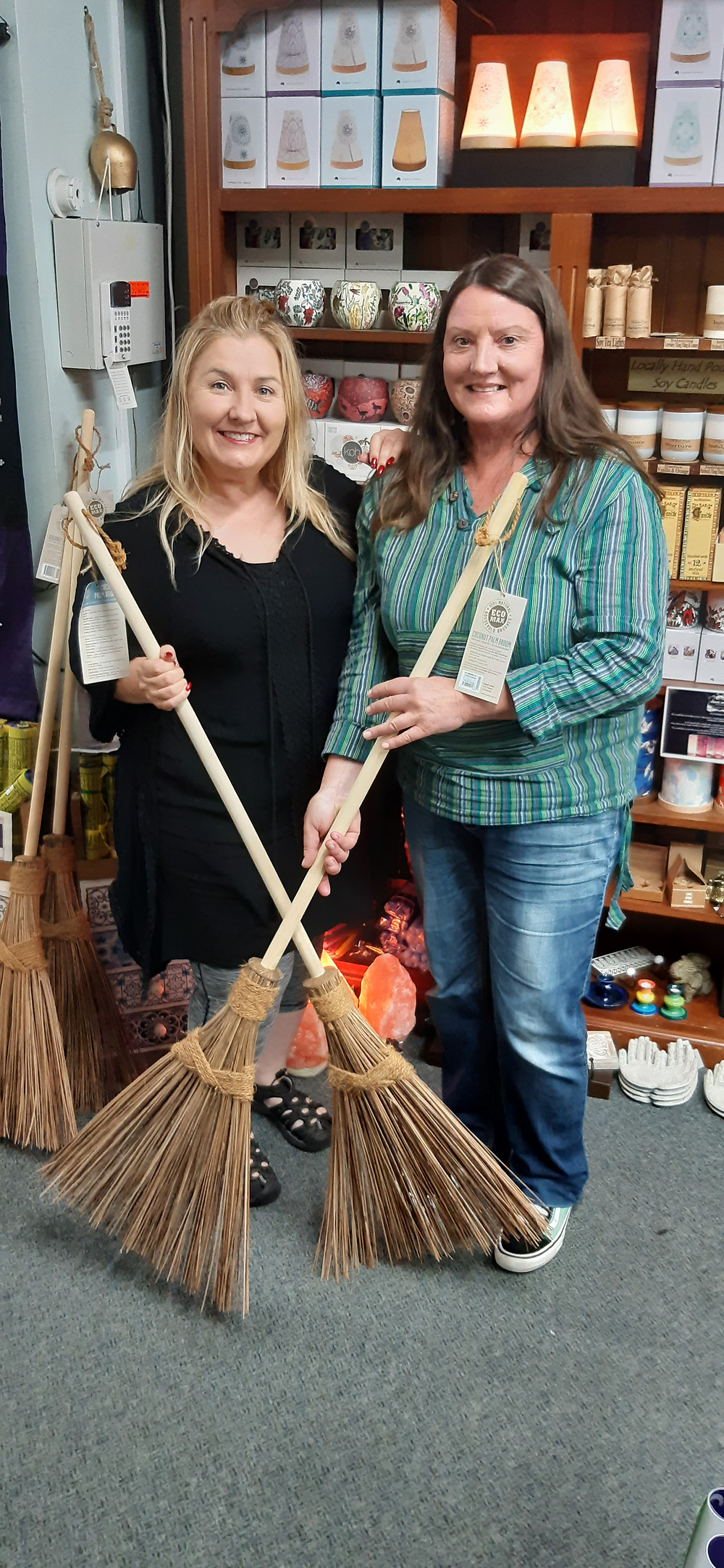 Lizzy and Mirelle with crossed brooms