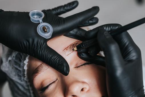Eyebrows microblading concept. Cosmetolo