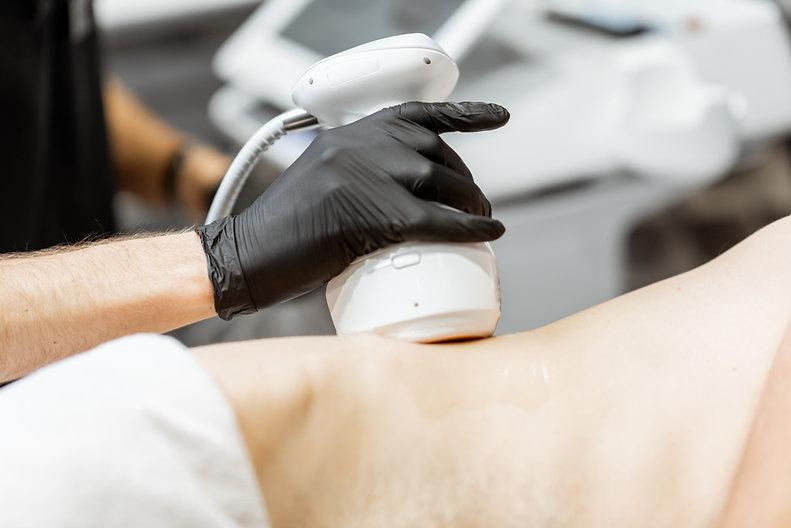 Man during an ultrasound liposuction pro
