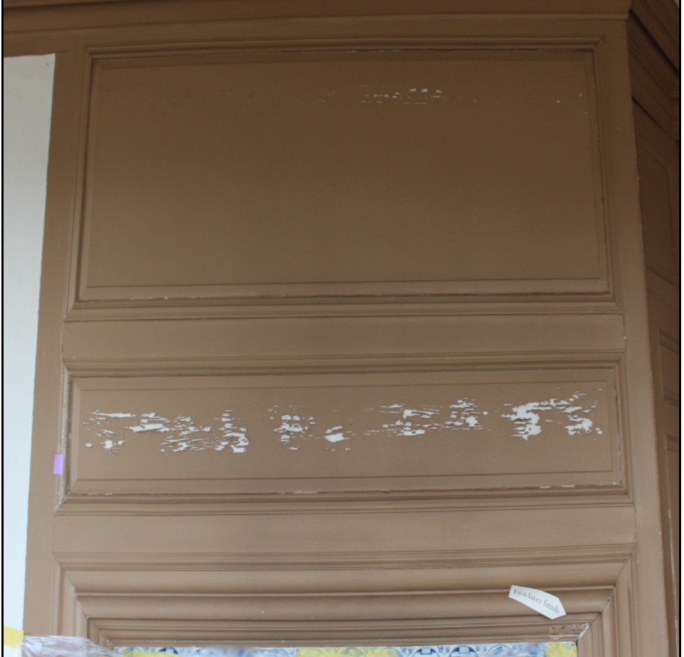 Peeling Panel above the Fireplace before Treatment