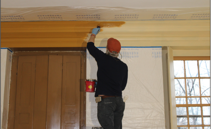 Chris Mills Painting the Cornice