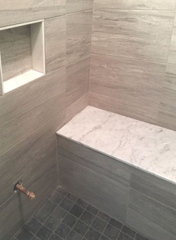 tiled shower inset niche and bench