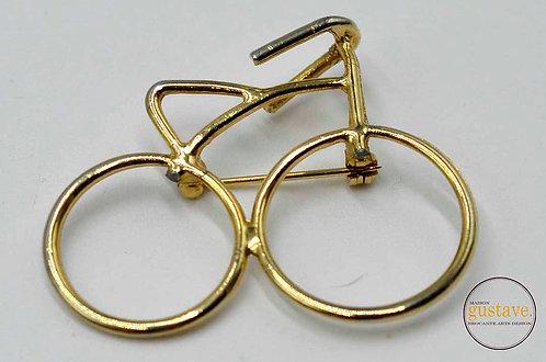 Broche minimaliste dorée bicyclette