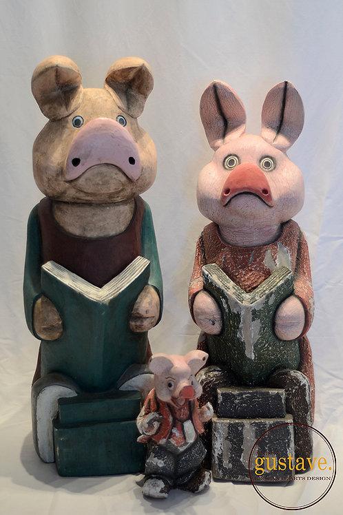 Cochons sculptés dans le bois