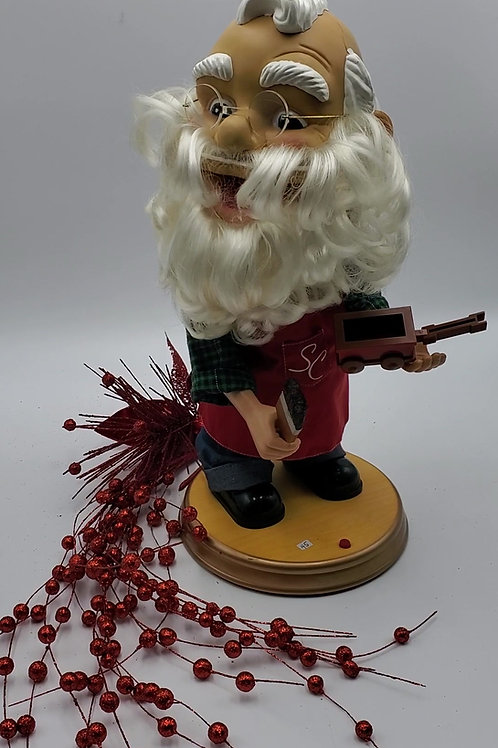 Père-Noël à grosse tête musical