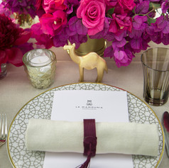 Shades of pink bouganvillea and roses with gold accents for a special celebration dinner in Marrakech