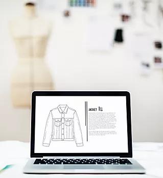 Laptop met Fashion Sketch.webp