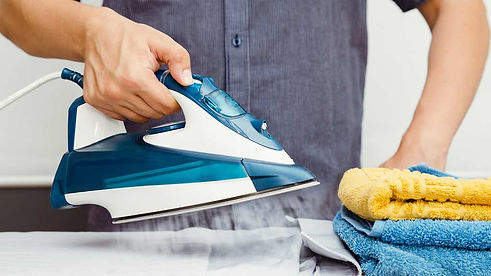 man using iron to do ironing.jpg