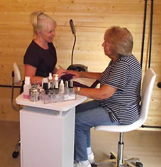 Maxine providing a nail treatment to one of her clients