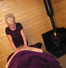 Maxine giving a massage, one of her many beauty treatments, to a client