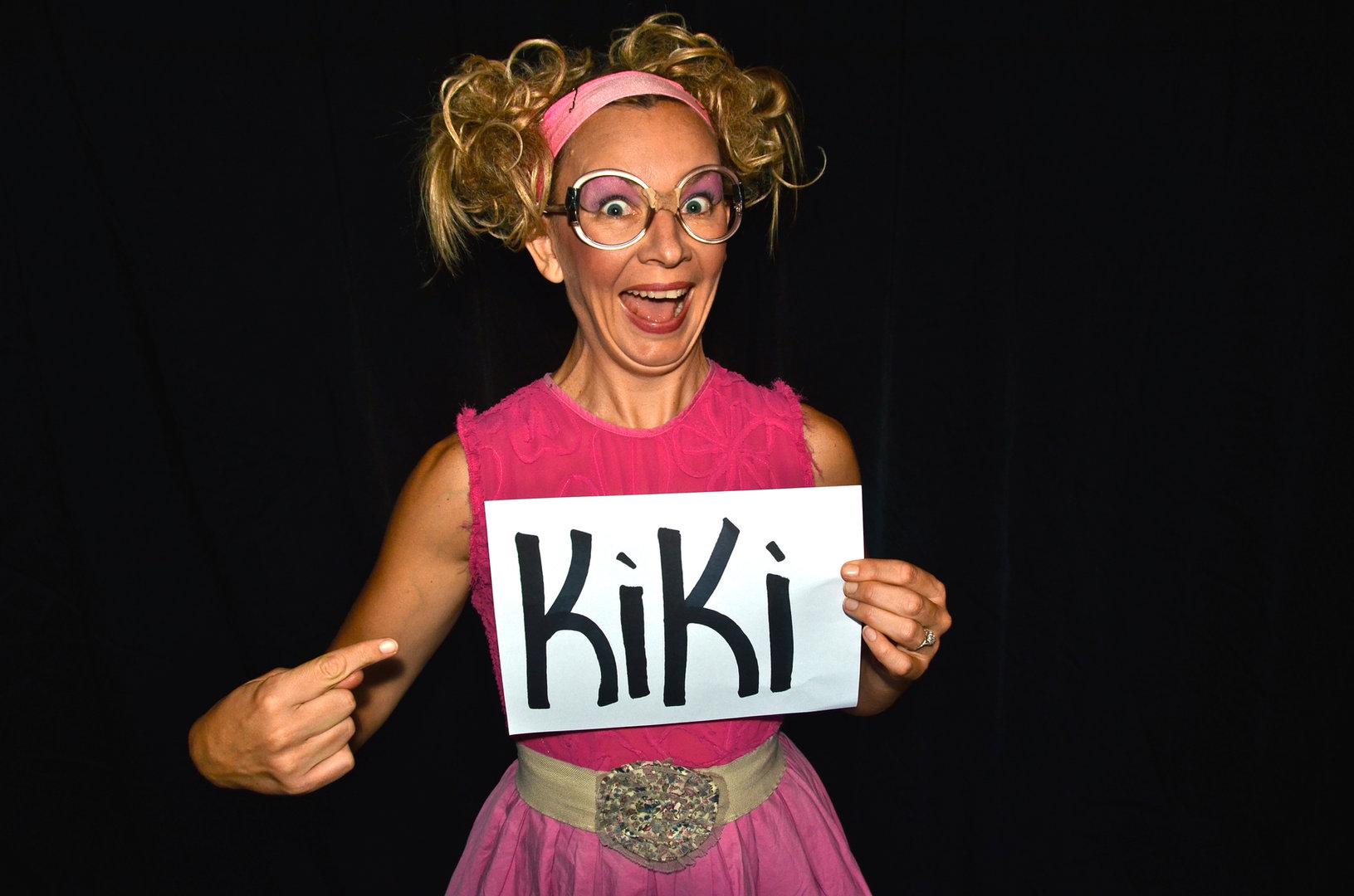 Kiki with sign.JPG