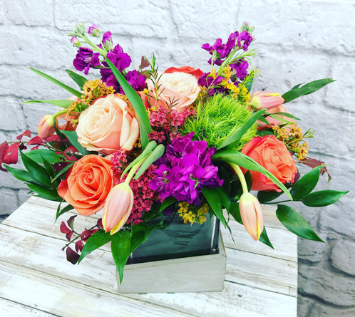 Pink stock a pleasing combination of orange tulips and orange roses hot pink stock and greenery fresh premium flowers mixed in an impressive and balanced design mightylinksfo