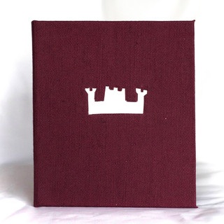 Book silk with paper castle cut out
