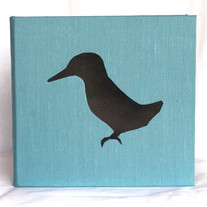 """""""Halcyon"""" Book silk and paper bird cut out"""