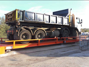 You use a weighbridge to check how much waste is coming onto your site...