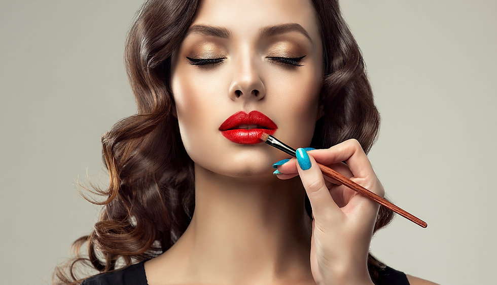 Makeup artist applies  red lipstick  .